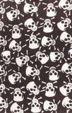 Tissu de coton avec un modèle des crânes et des os Photographie stock libre de droits