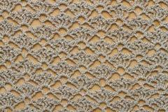 Tissu de crochet sur le panneau en bois photo stock