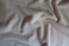 Tissu de laine en ivoire plié de débardeur d'en haut Photos stock