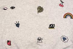 Tissu de textile de fond qu'un gris colore avec les éléments décoratifs image libre de droits