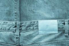 Tissu de texture de couleur d'indigo de vêtements de jeans Images stock