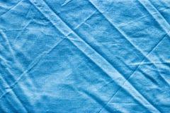 Tissu de toile bleu chiffonné Photographie stock libre de droits