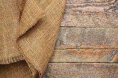 Tissu de toile de jute et abrégé sur texture en bois Photographie stock