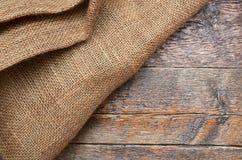 Tissu de toile de jute et abrégé sur texture en bois Photos libres de droits