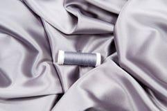 Tissu en soie et amorçage Images stock