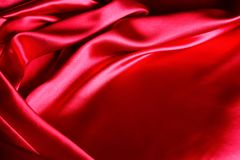 Tissu en soie rouge Photos stock