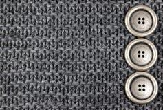 Tissu et boutons tricotés image stock