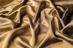 Tissu fait d'or métallique d'éclat de fil en métal de tissu en soie Jus Images stock