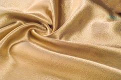 Tissu fait d'or métallique d'éclat de fil en métal de tissu en soie Jus Photo stock