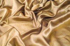 Tissu fait d'or métallique d'éclat de fil en métal de tissu en soie Jus Photographie stock