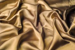 Tissu fait d'or métallique d'éclat de fil en métal de tissu en soie Jus Photos stock
