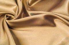 Tissu fait d'or métallique d'éclat de fil en métal de tissu en soie Jus Photographie stock libre de droits