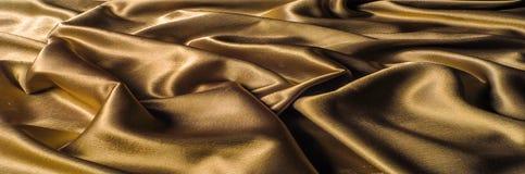Tissu fait d'or métallique d'éclat de fil en métal de tissu en soie Jus Photos libres de droits