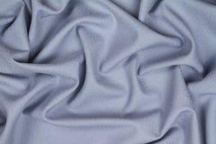 Tissu froissé chiffonné de laine bleu avec des vagues Photos stock
