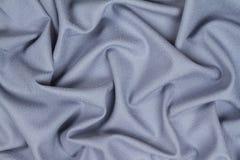 Tissu froissé chiffonné de laine bleu avec des vagues Images libres de droits
