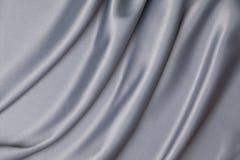 Tissu gris de satin photo libre de droits