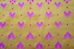 Tissu jaune avec des coeurs Images libres de droits