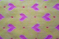 Tissu jaune avec des coeurs Photographie stock