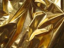 Tissu métallique d'or photographie stock libre de droits