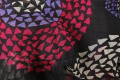 Tissu noir avec le rose et le bleu Image stock