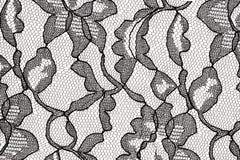 Tissu noir de lacet avec la configuration de fleur Photographie stock