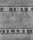 Tissu noir et blanc de jeans avec des ficelles et des coutures Photo stock