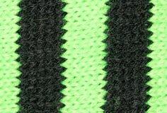 Tissu noir et vert tricoté Photographie stock