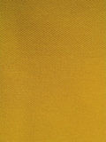 Tissu orange de denim Photos libres de droits