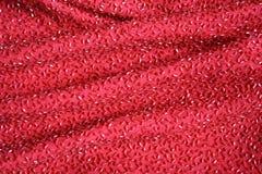 Tissu perlé rouge de lux Photo stock