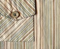 Tissu rayé et une poche là-dessus Photos libres de droits