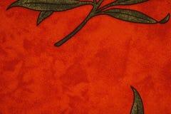 Tissu rosso con la foglia Fotografia Stock