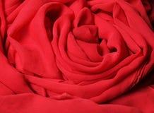 Tissu rouge débordant Photo stock