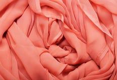 Tissu rouge débordant Image libre de droits