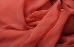 Tissu rouge débordant Images stock