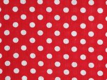 Tissu rouge de point de polka Photographie stock libre de droits