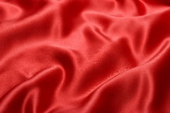 Tissu rouge de satin Photographie stock
