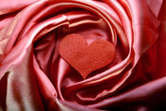 Tissu rouge de satin Photographie stock libre de droits