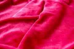 Tissu rouge plissé Photographie stock libre de droits
