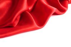Tissu rouge sur un fond blanc images stock