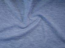 Tissu synth?tique pliss? par gris tir? photo stock