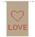 Tissu tricoté avec le coeur Photographie stock