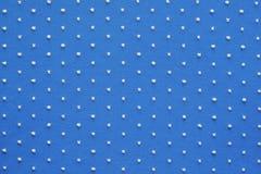 Tissu tricoté de couleur bleue avec les points blonds pelucheux Photos libres de droits