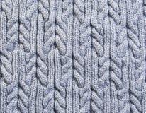 Tissu tricoté par fond gris Photos stock