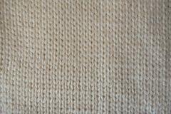 Tissu tricoté par stockinette simple fait main crème Photo libre de droits