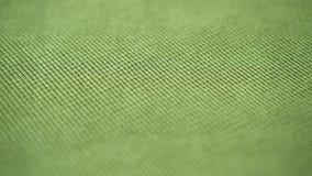 Tissu vert texturisé extrêmement étroitement  banque de vidéos