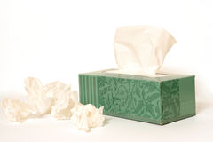 Tissue Box. A box of tissue with used tissues around it Royalty Free Stock Photo