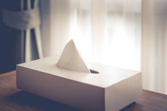 Tissue box white on brown wood floors.  Royalty Free Stock Photo