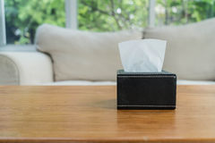 Tissue boxes. On wood table Royalty Free Stock Images