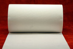 Tissue Paper. A roll of Tissue Paper on a red background royalty free stock images