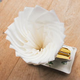 Tissue paper on wood table Stock Photography